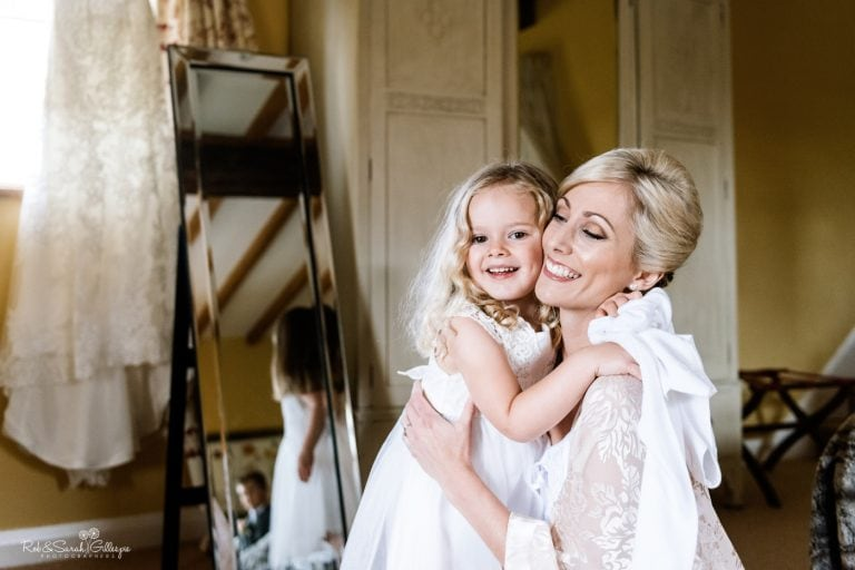 Bride and flowergirl get ready for wedding