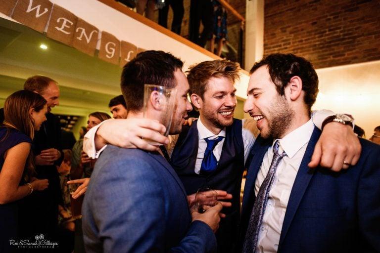 Groom and friends on dancefloor at Delbury Hall wedding