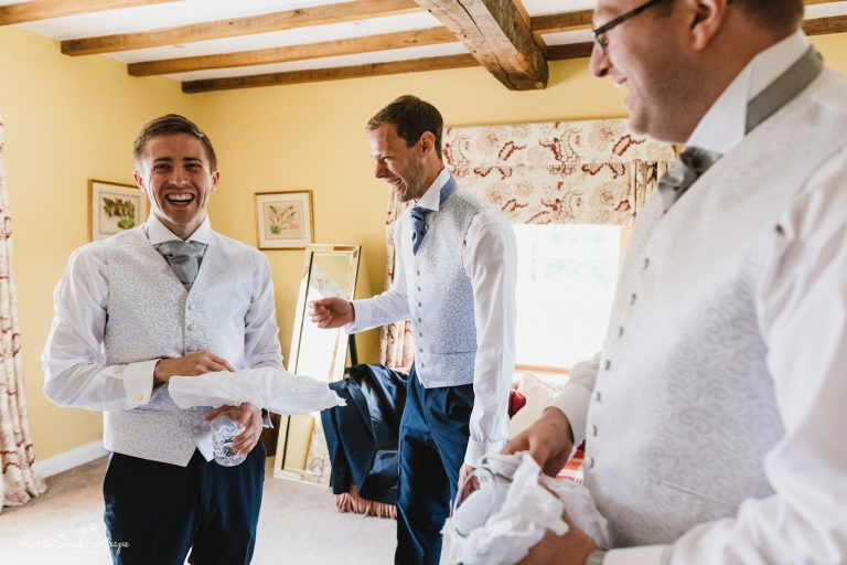Groom and friends prepare for wedding
