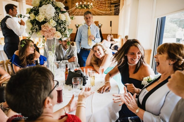 Guests laughing at Delbury Hal wedding reception