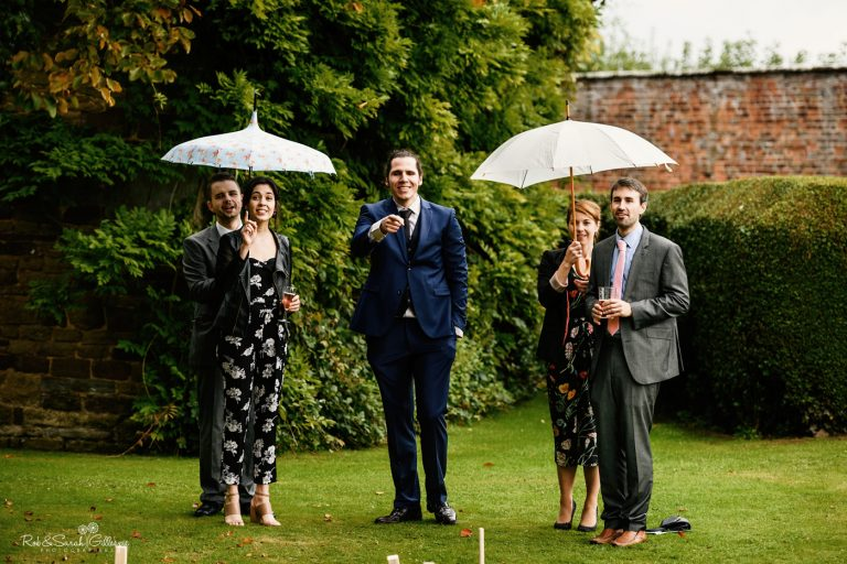 Wedding guests relax and play games at Delbury Hall