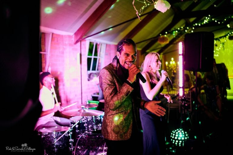 Live band perform at wedding in barn at Gorcott Hall