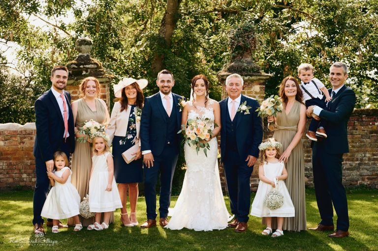 Wedding group photo in gardens at Gorcott Hall