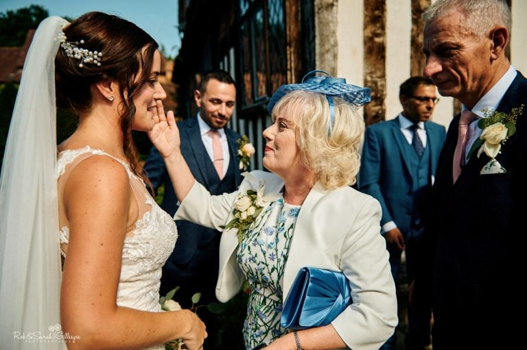 Guest congratulates bride after wedding ceremony