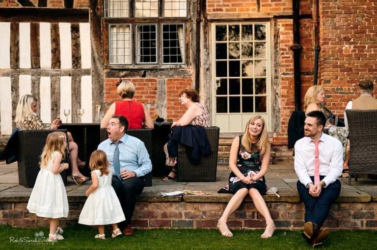 Wedding guests relax during evening reception at Gorcott Hall