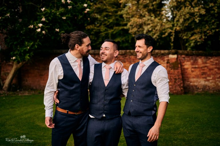 Groom and friends laughing together