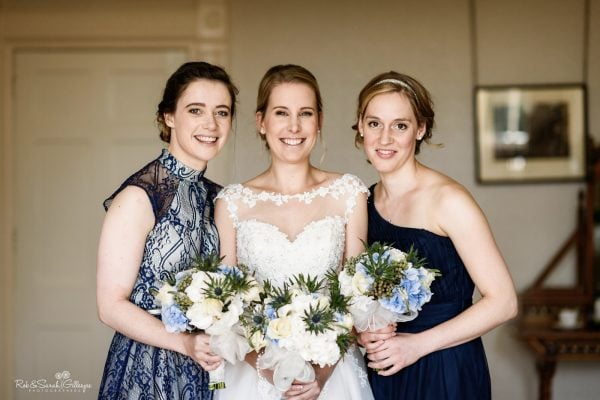 Group photo of bride and two bridesmaids in bedroom at Highbury Hall