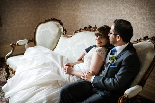 Bride and groom on antique couch