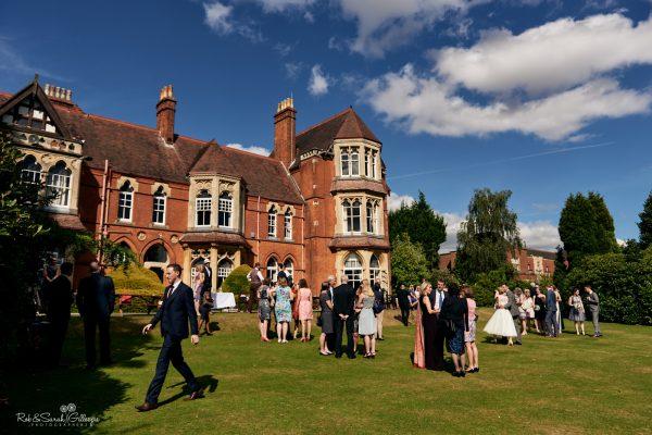 Wedding drinks reception in gardens at Highbury Hall on a sunny day