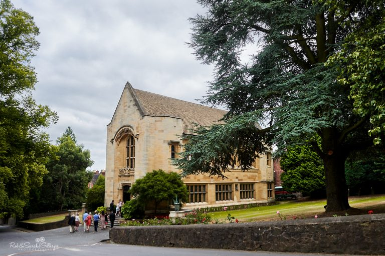 Exterior of Memorial Library at Malvern College with wedding guests arriving