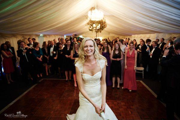 Bride prepares to toss boquet at wedding reception
