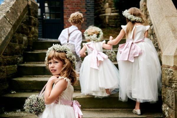 Flowergirl looks around while walking up stone steps