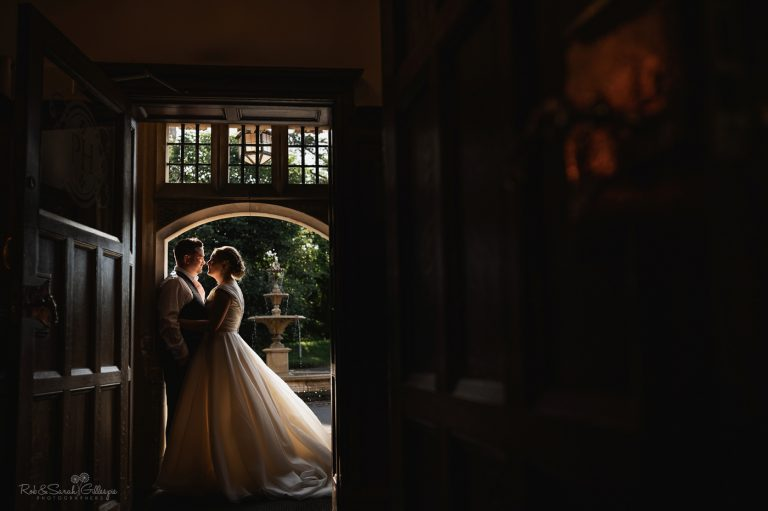 Bride and groom in doorway at Pendrell Hall