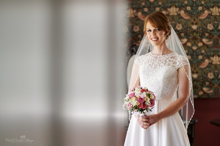 Portrait of bride in Strawberry Thief bedroom at Pendrell Hall