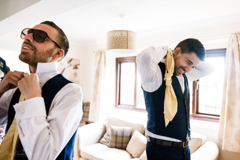 Groom and friend get ready for wedding