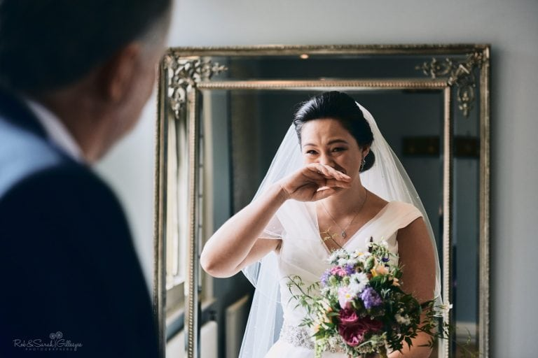Bride emotional as father sees her in wedding dress