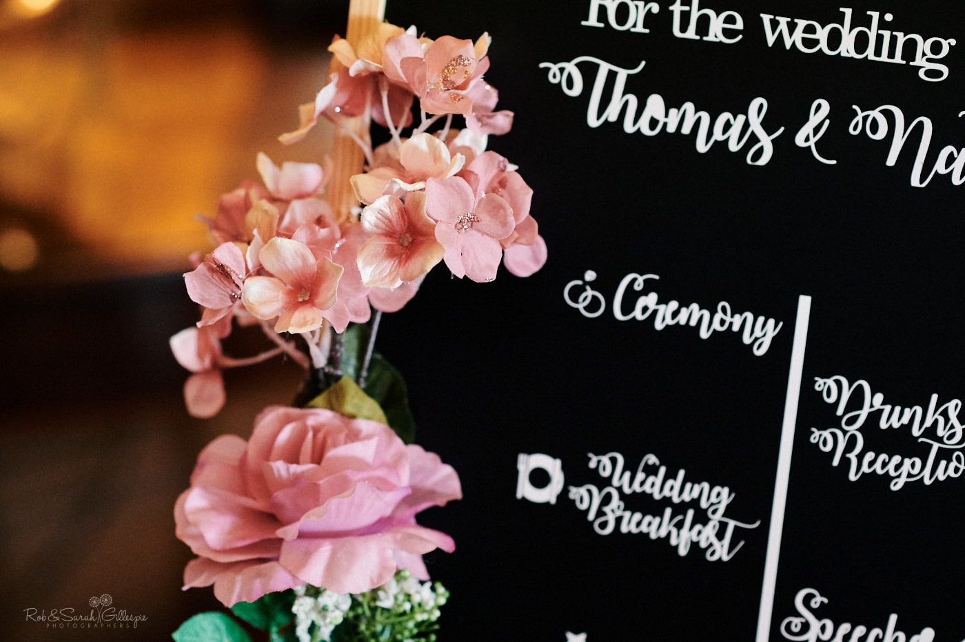 Detail of flowers on order of service board