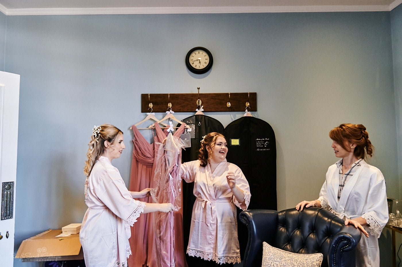 Bride and bridemaids prepare for wedding in Love Is Enough room at Pendrell Hall