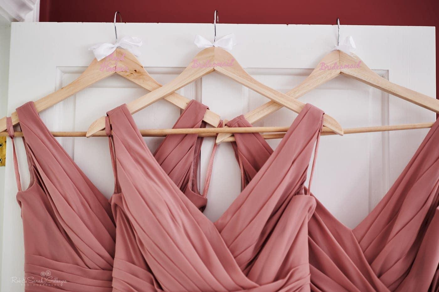 Pink bridesmaids dresses on hangers