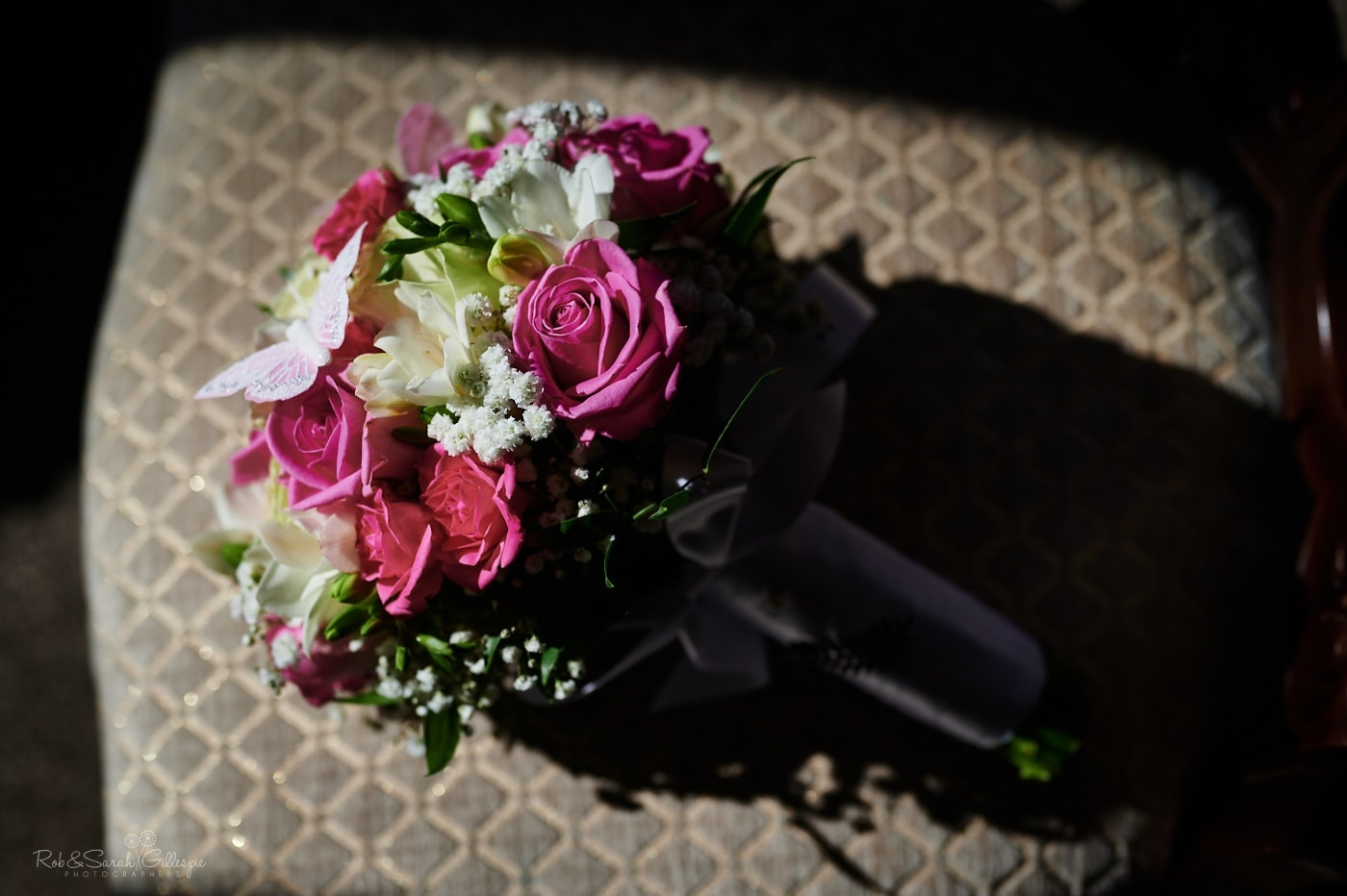 Pink and white bouquet of flowers on shar in strong daylight