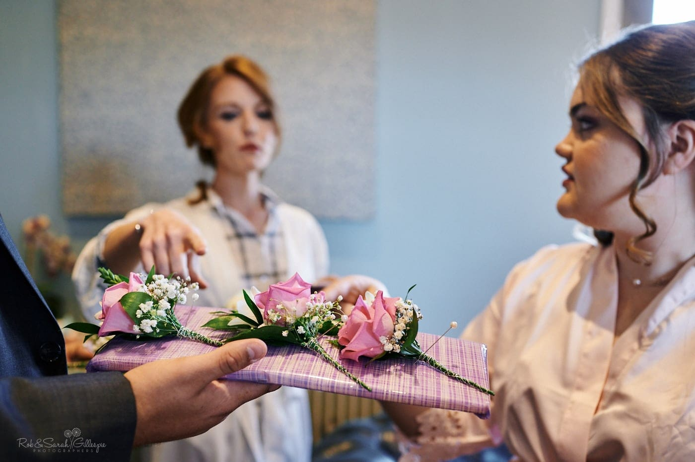 Bride and bridesmaids check buttonhole flowers