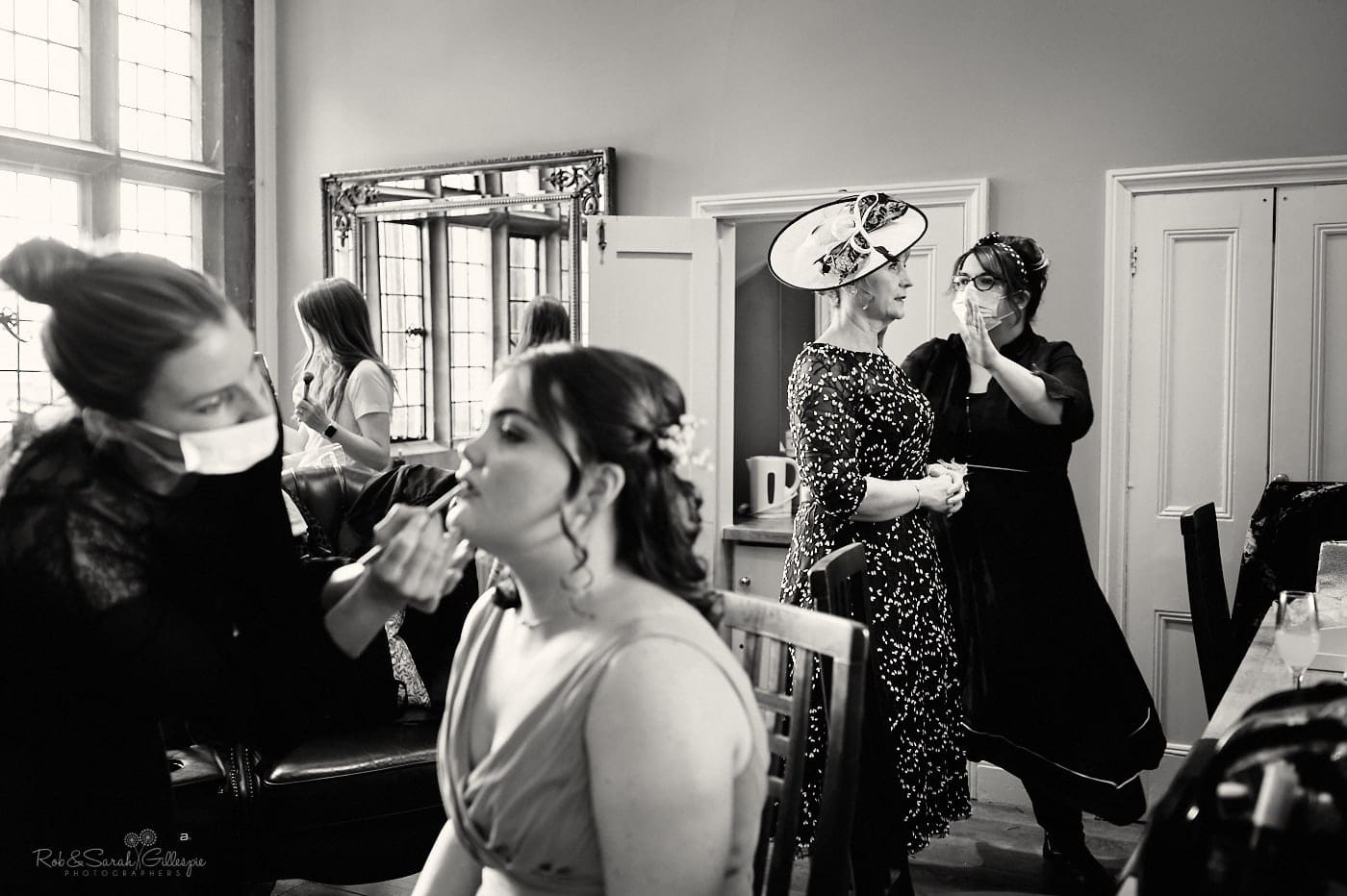 Bridesmaid and bride's mother have hair and makeup in Love Is Enough room at Pendrell Hall