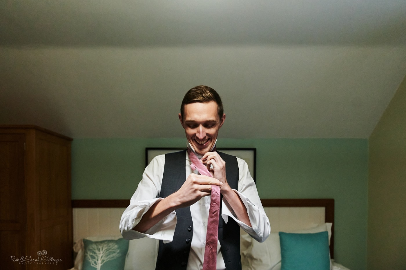 Groom fixes tie in room at Pendrell Hall