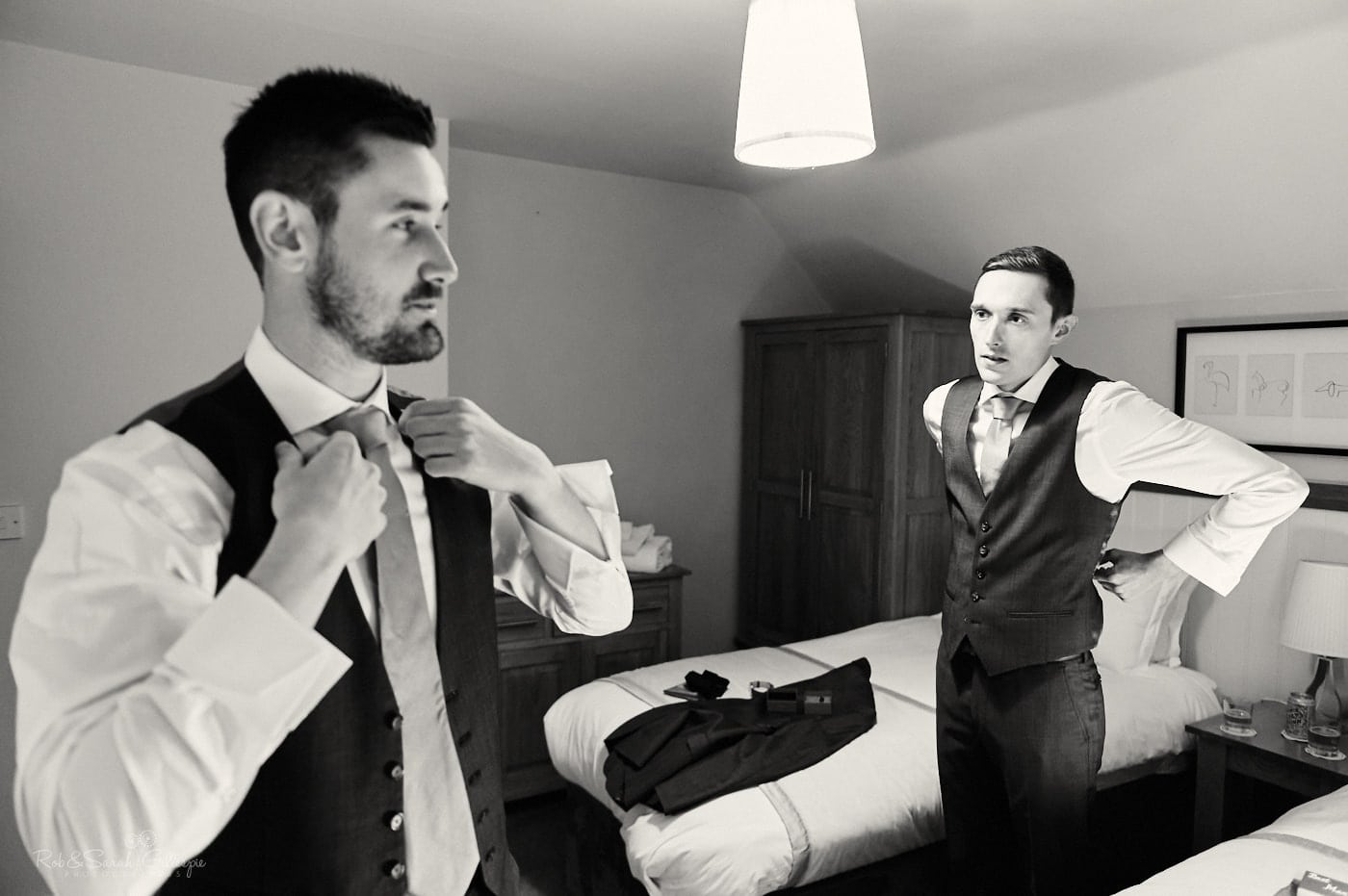 Best man and groom prepare for wedding at Pendrell Hall