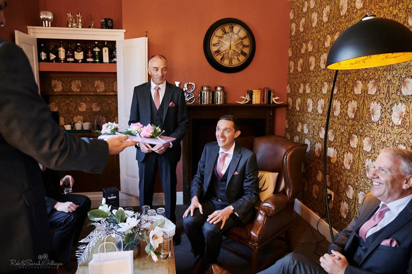 Groom and groomsmen prepare for wedding in Pimpernel Suite at Pendrell Hall