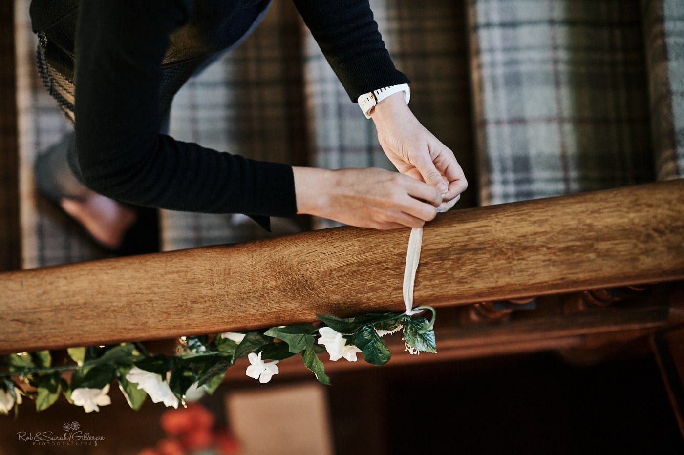 Pendrell Hall staff tie flowers to bannister rail