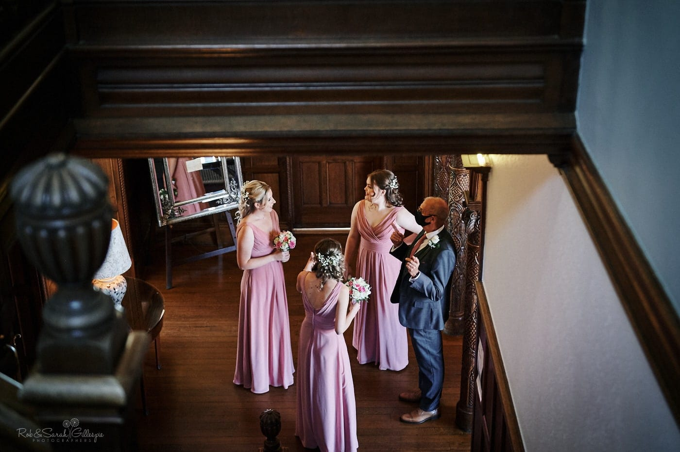 Bridesmaids chat while waiting for bride