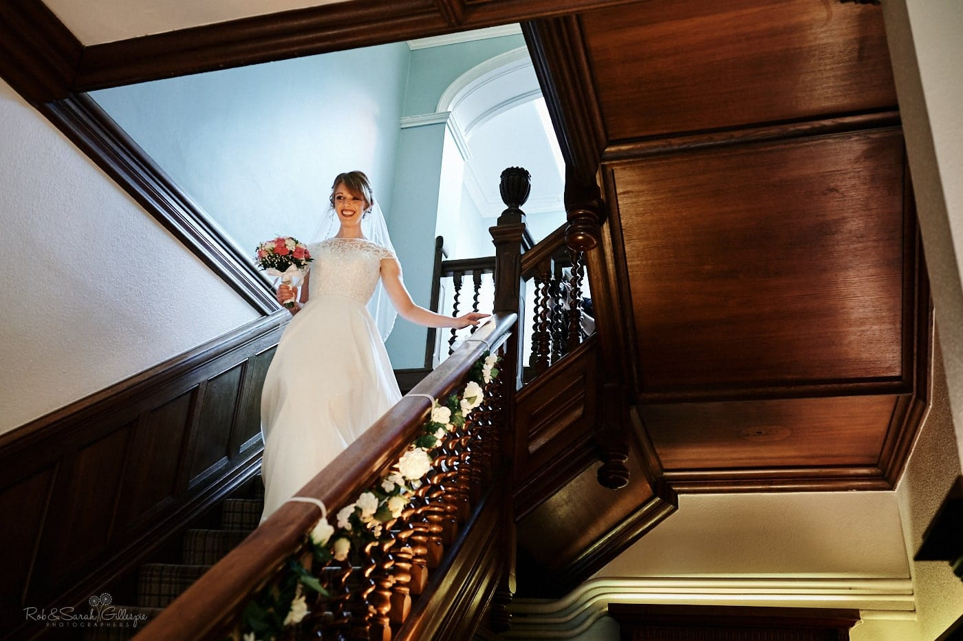 Bride on wooden staircase at Pendrell Hall