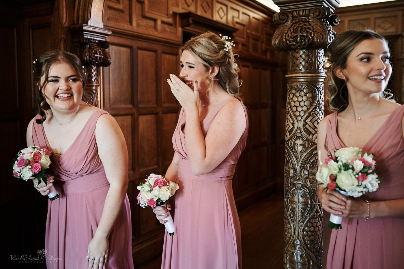 Bridesmaids laughing and emotional as bride makes her entrace