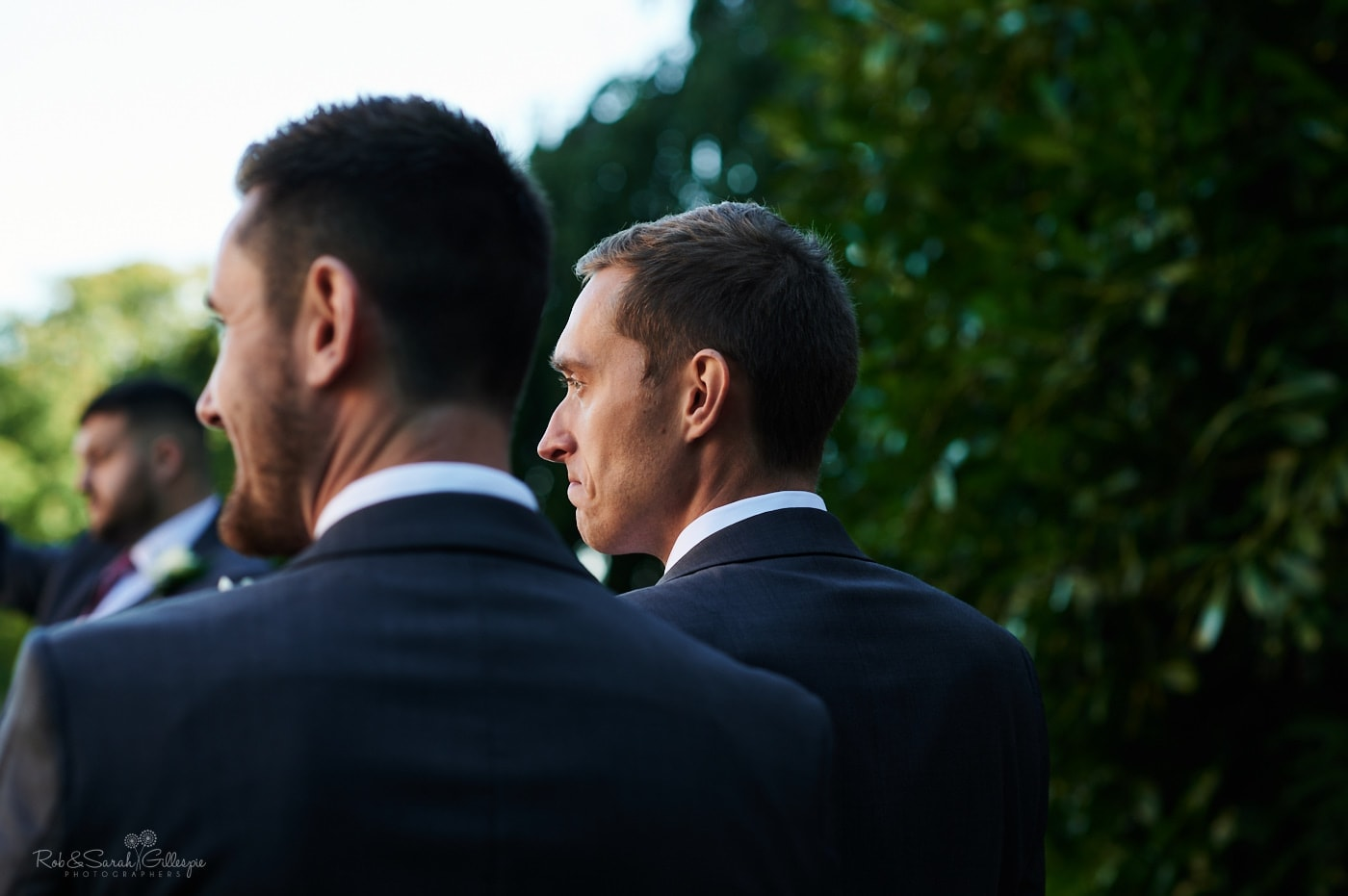 Groom watches as his bride walks up aisle