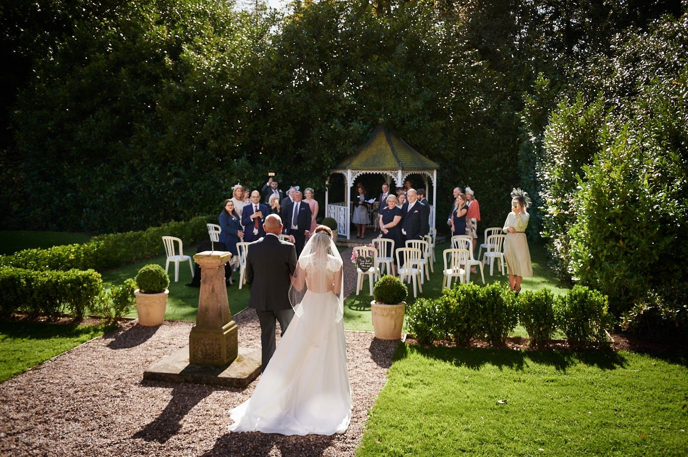 Outdoor wedding creremony in gardens at Pendrell Hall