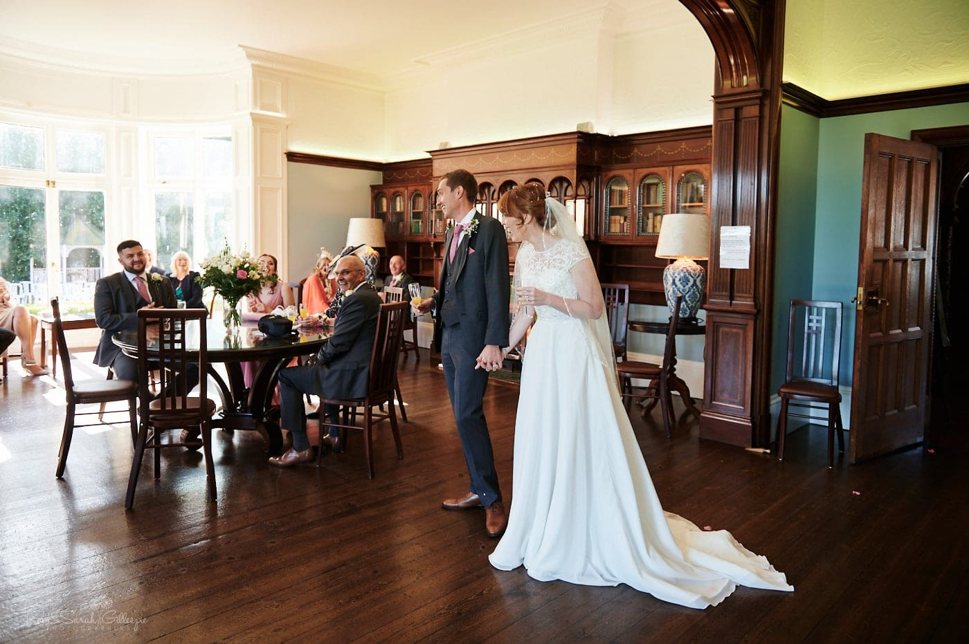 Bride and groom chat to guests at small wedding