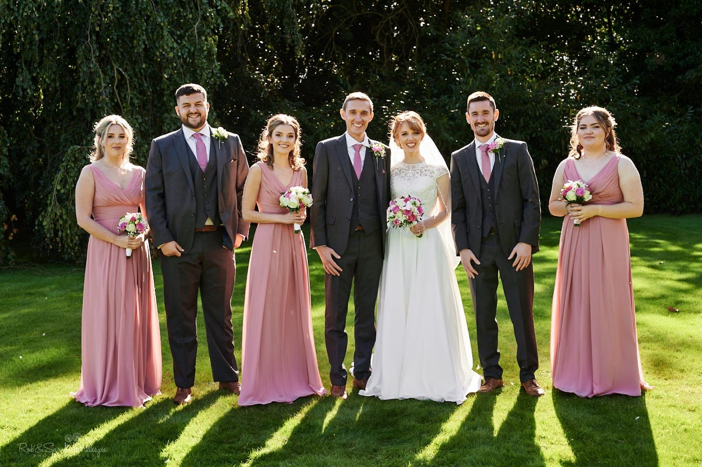 Group photo of bride, groom, bridesmaids, best man at Pendrell Hall