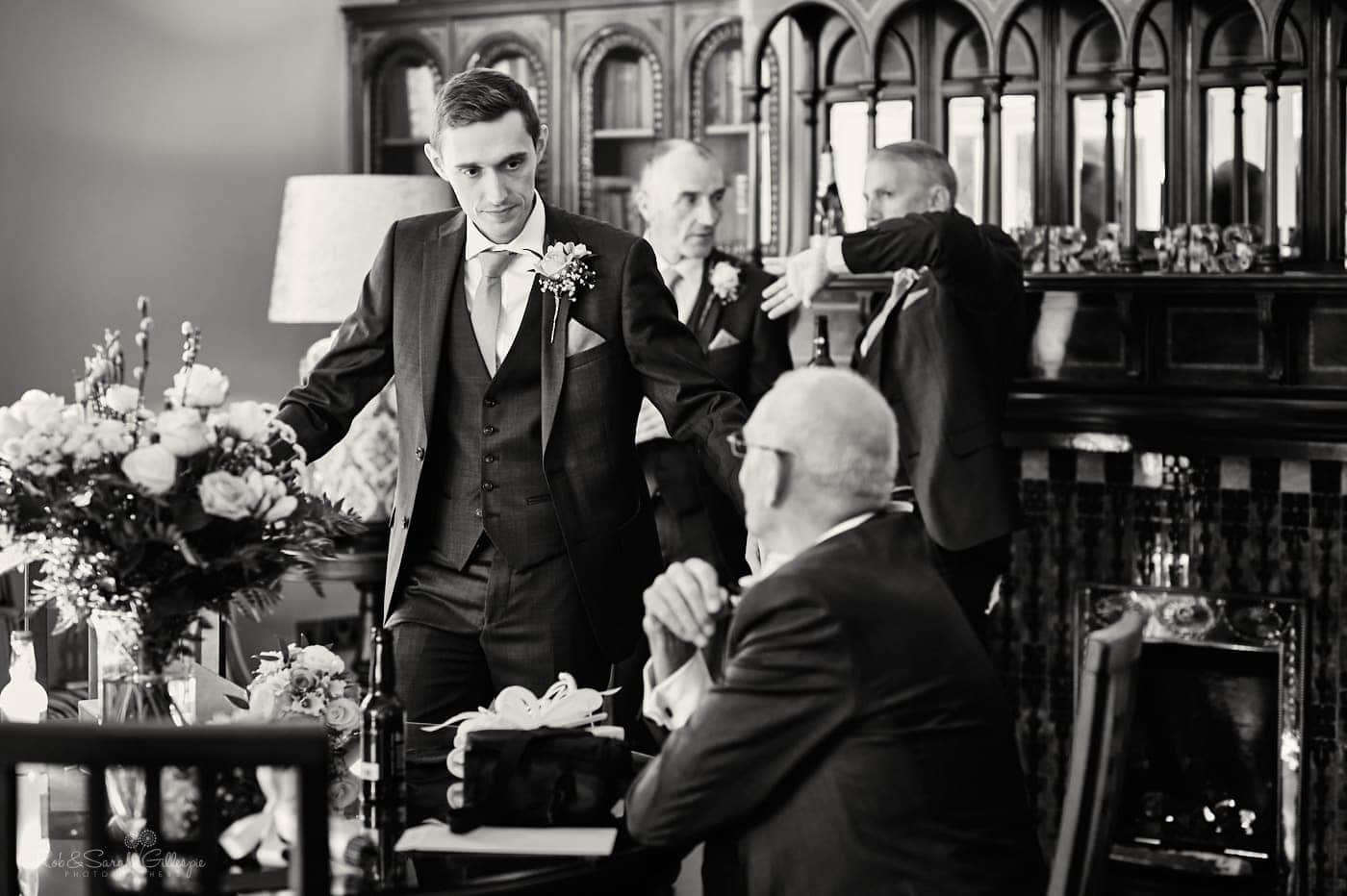 Groom chats with wedding guests
