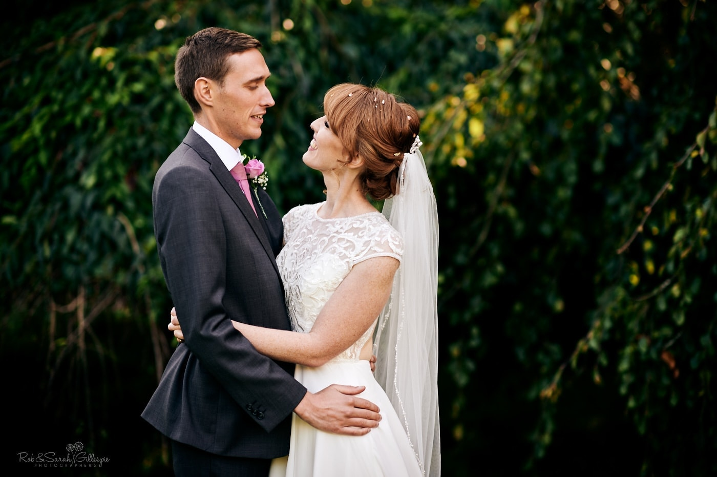 Bride and groom relax together in gardens at Pendrell Hall