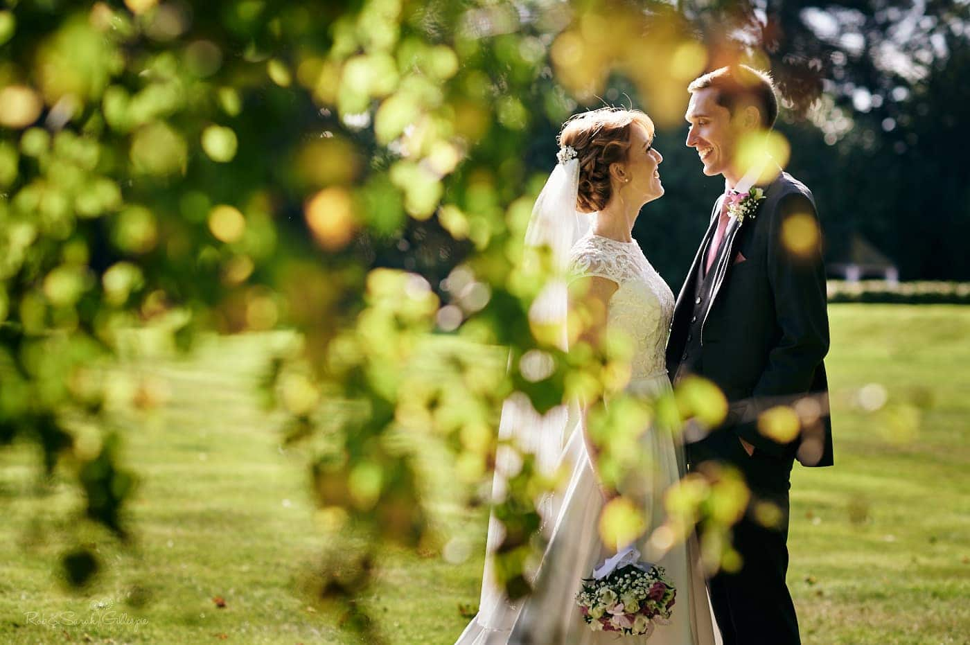 Bride and groom relaxing together in gardens
