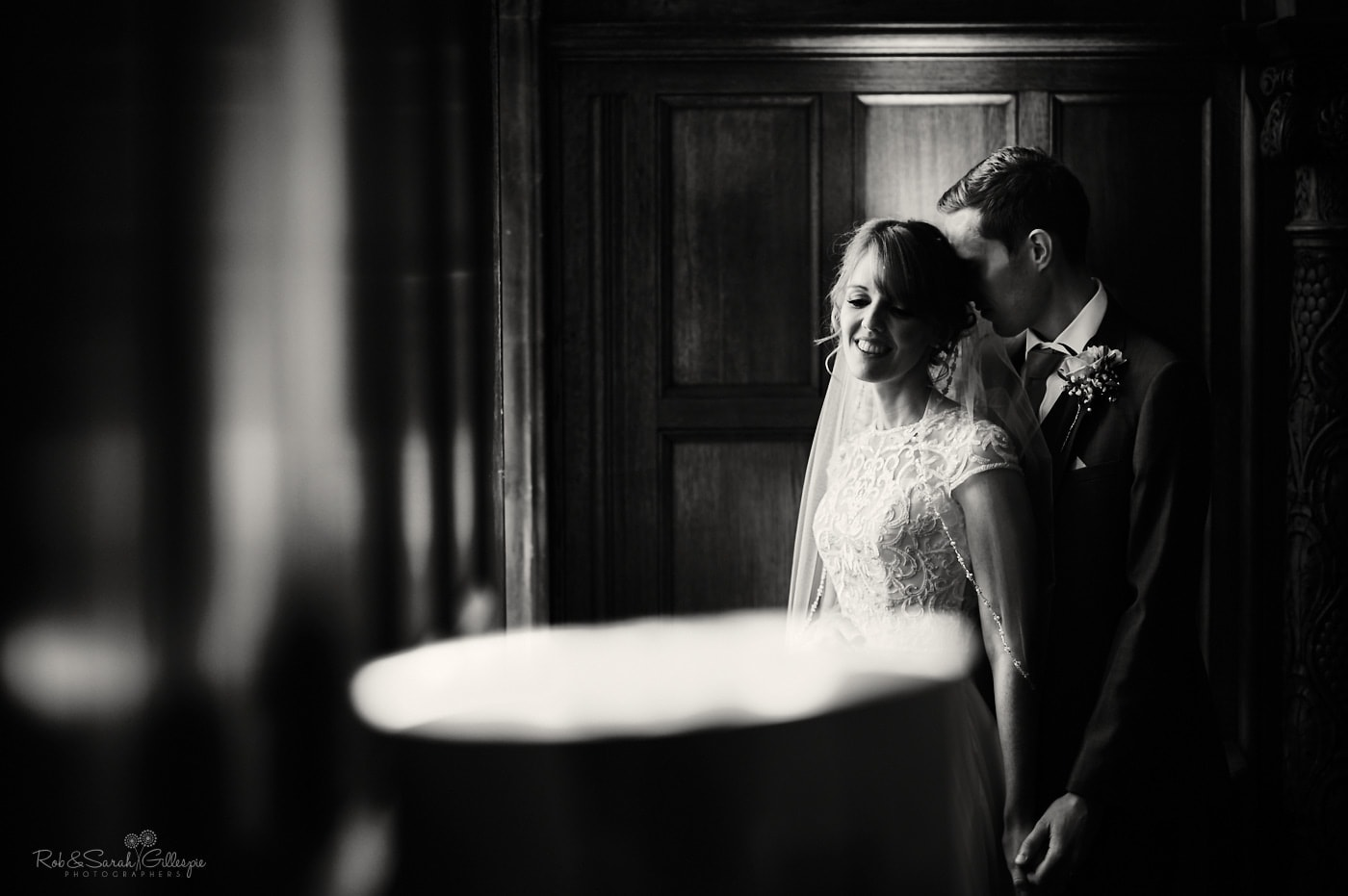Newly married couple share quiet moment in Pendrell Hall room