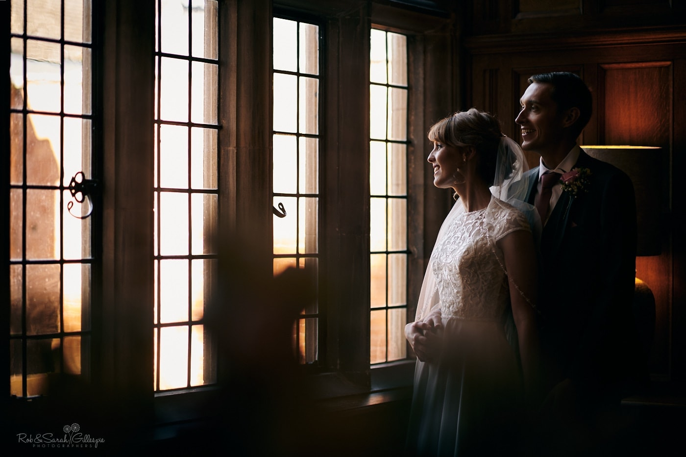 Bride and groom in panelled room at Pendrell Hall