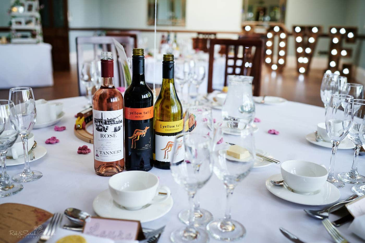 Wine bottles and table places for wedding meal at Pendrell Hall