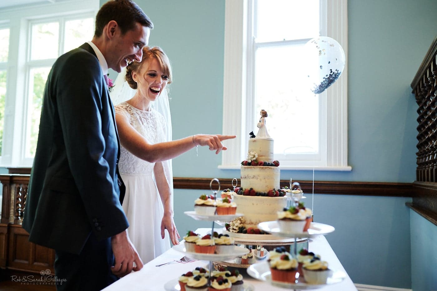 Bride and groom checking wedding cake at Pendrell Hall