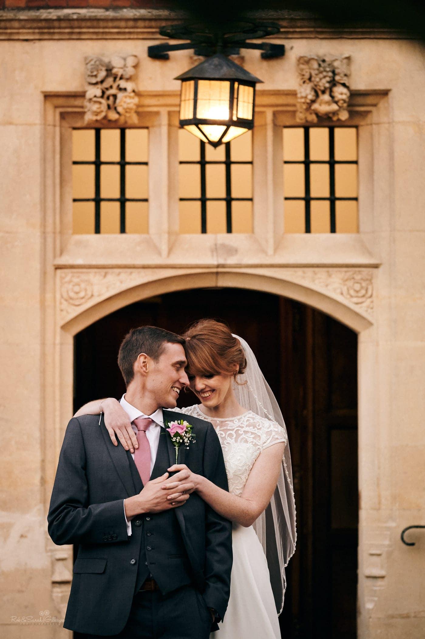 Bride and groom hug outside Pendrell Hall entrance
