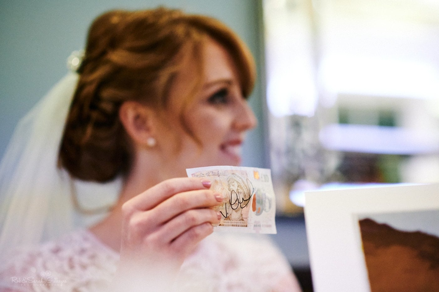 Bride holds £10 note as magician performs