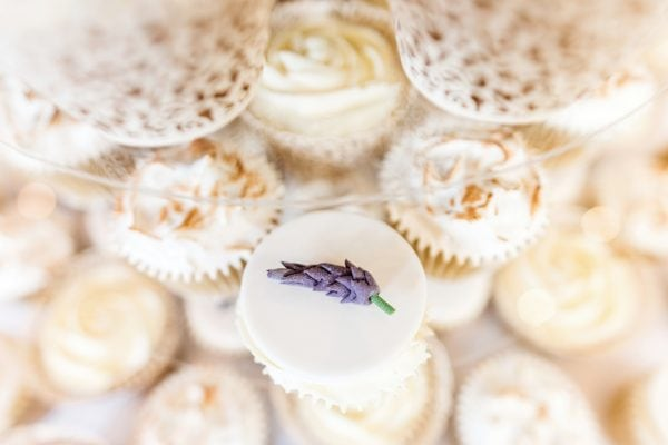 Detail of wedding cupcakes with heather flower icing