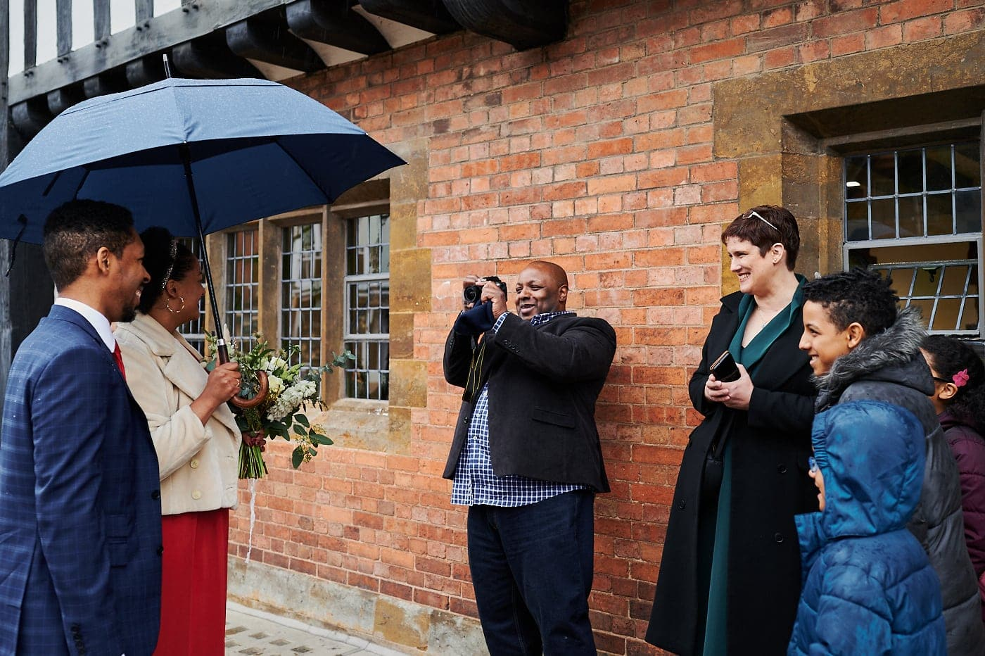 Bride and groom meet family outside The Henley Room in Stratford-upon-Avon