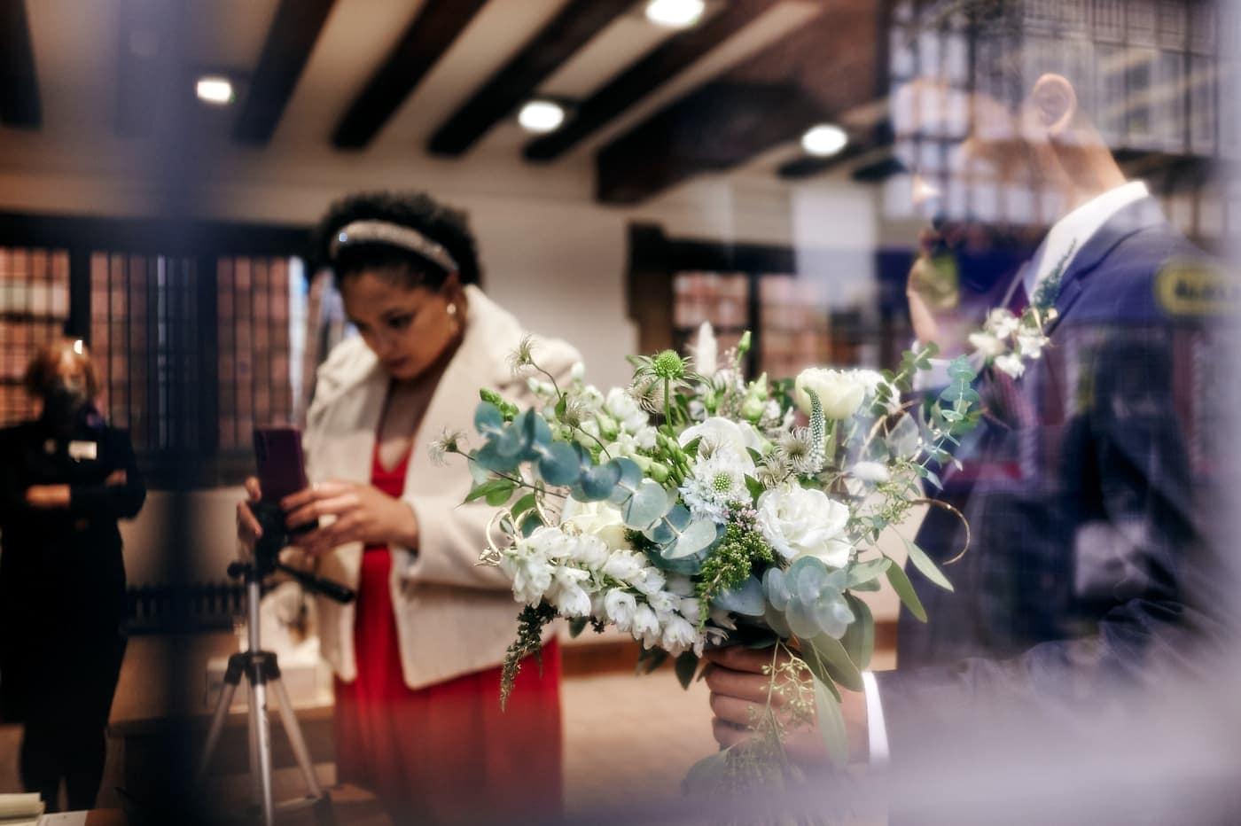 Groom hold's bride's bouqeut
