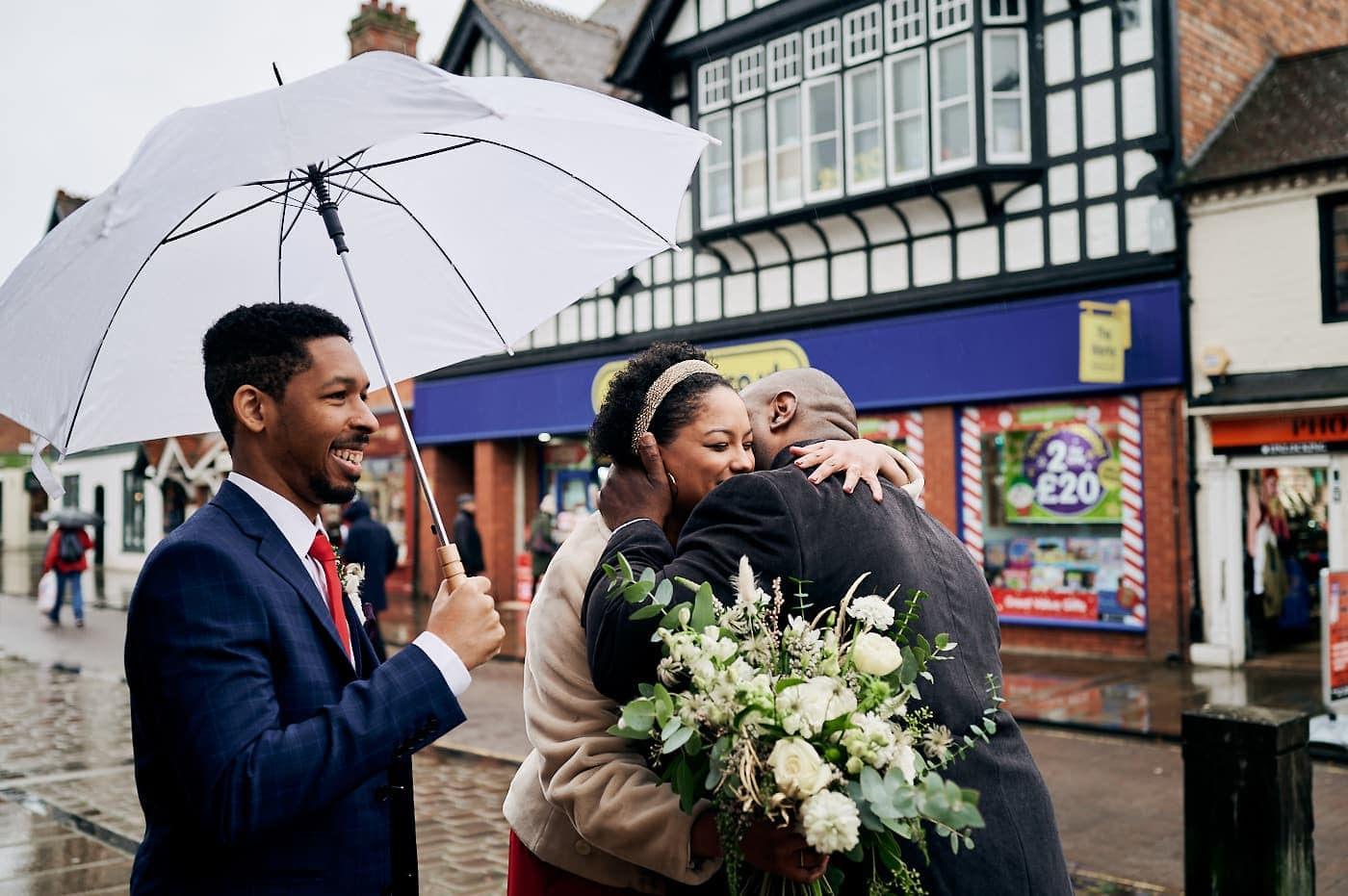Bride hugs dad after small wedding in Stratford-upon-Avon